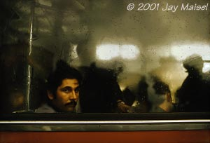 � 2001 Jay Maisel - Man in Train Window