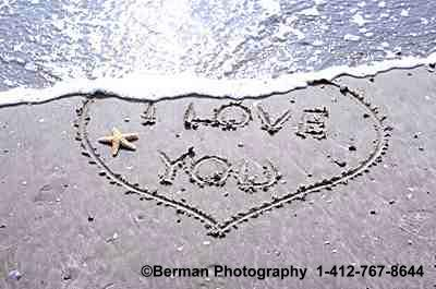 sequence photographs of heart washing away in the sand